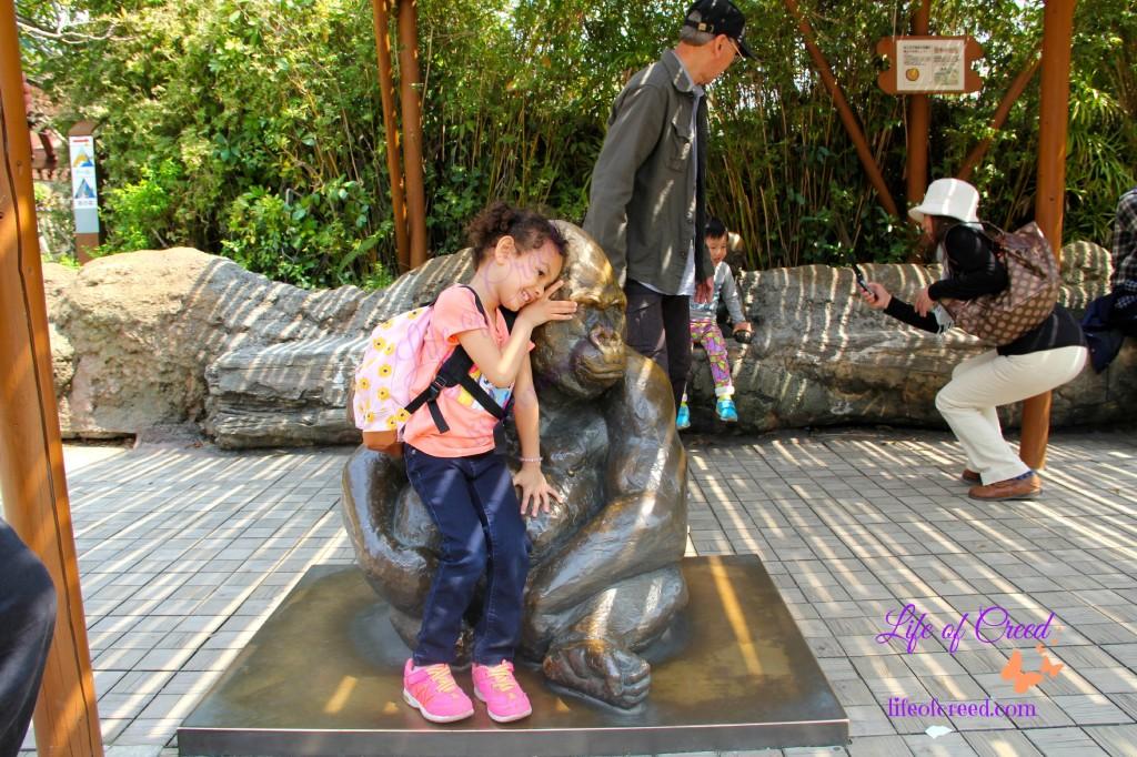Toddler girl enjoying the zoo